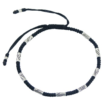 Macrame bracelet with silver ornate beads