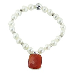 Pearl bracelet with red carnelian charm and silver spiral bead