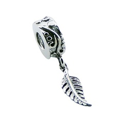 Silver fern leaf charm on cylinder bead