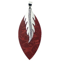 Flat red coral marquise pendant with decorated silver leaf clasp
