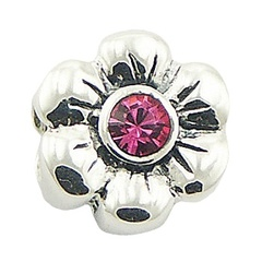 Double sided sterling silver fluted flower bead with two Swarovski crystals