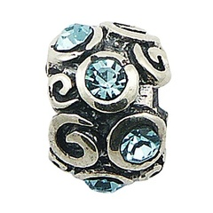Antiqued casted sterling silver bead with shiny twirls and seven Swarovski crystals