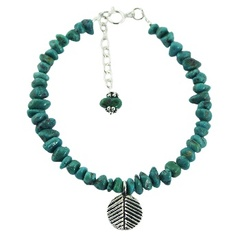 Silver bracelet with turquoise beads of free shape and silver leaf charm