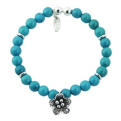 Stretch bracelet with round turquoise beads & silver flower charm